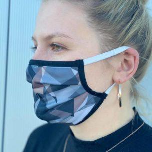 Mund- Und Nasenmasken Im Dreiecksmuster
